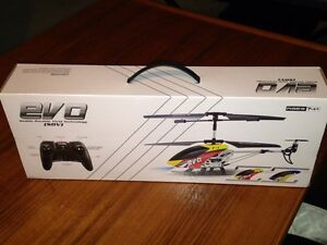 Brand new. Never opened. Evo T1 Toy Helicopter with remote London Ontario image 5