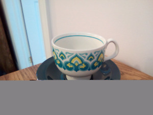 Set of eight retro tea cups and saucers. Teal.