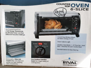 """REDUCED!RIVAL Counter-top oven,w/ racks and pans,cooks 12"""" pizza"""