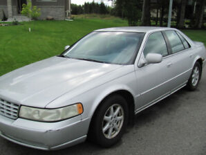 """2001 Cadilac Seville SLS for sale """"as is"""" 218000 km. Some rust."""