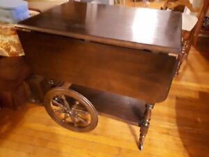 antique liquour cart with drop leafs and wagon wheels