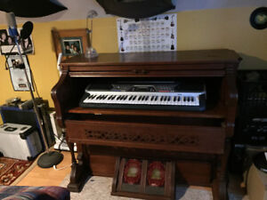 Antique pump organ shell with electronic keyboard