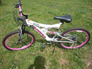 Like new red and pink nitrous supercycle bicycles