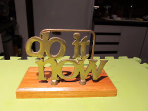 Various brass and wood desk organizers.