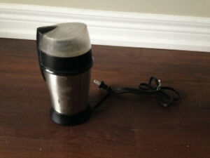 Coffee Mill stainless steel body with a clear top