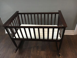Dark wood rocking bassinet