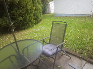 Patio set, 4 chairs, covering, seat cushions.