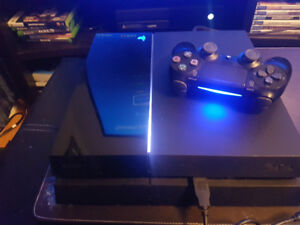 PS4 ORIGINAL 1TB with games and stand sold separately!