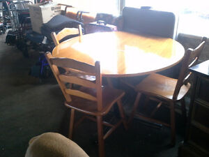 round table and 3 chairs  $50.