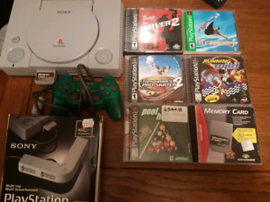Sony Ps1 with 5 games, 1 controller and 1 memory card