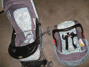 Stroller with detachable baby carrier