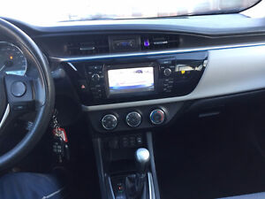 2014 Toyota Corolla LE 1 owner. 100% accident free, bk camera