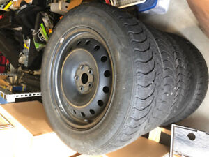 4 WINTER CLAW TIRES 235/65R18 WITH STEEL RIMS