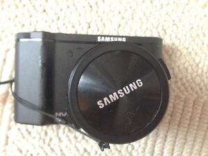 Samsung NV7 7.2MP Digital Camera with 7x Optical Image Stabilize