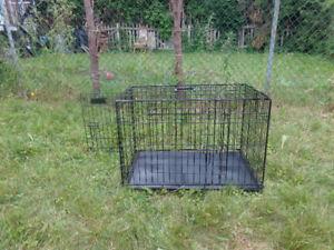 Cage a chien comme neuf de couleur Noir en très bon état. Voici