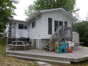 NEW PRICE Mississippi lake Waterfront West facing cottage/home,