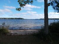 Big Rideau Lake waterfront with sand beach