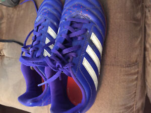 Youth soccer cleat by Adidas, size 2.