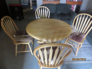 Solid Wood Dining Tabe and Chairs (cushions included)