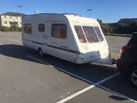 2004 sterling Europa 4/5 berth fixed end bed with awning in good condition comes with everything