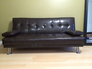 Futon couch. Can deliver