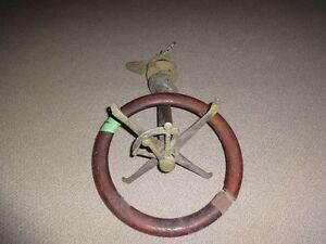 steering wheel/shaft from old wooden boat.