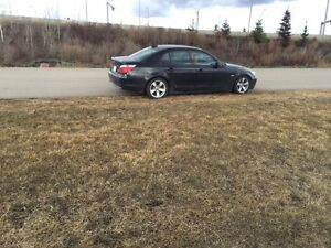 2006 BMW 525i.  2 sets of wheels and tires. 9500