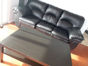 Leather black sofa and coffee table