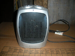 Small ceramic heater with fan