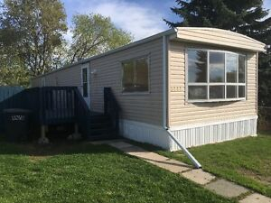 Newly renovated mobile home for rent on a large, landscaped lot