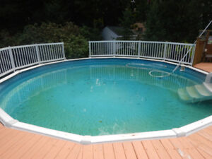 24 foot above ground pool and deck