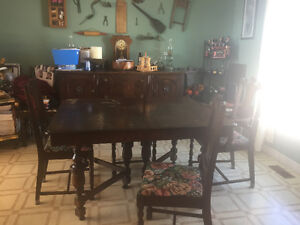 Over 100 year old dinning room table buffet and six chairs