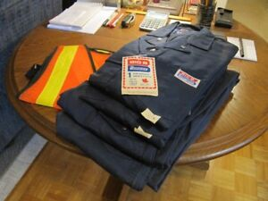 """(4) Pairs of new """"Big B""""  M navy coveralls and (1) safety vest."""