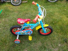 Paw patrol bike with stabilizers