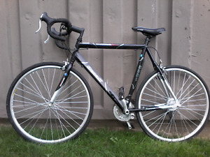 Road bike Trade for dlsr camara or canon lens trade only adult