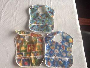 Bumpkins plastic bibs (3), with food catchers