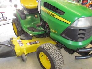JOHN DEERE LA 140/ 54 AND 48 INCH MOWER/PLOW/WEIGHTS/CHAINS