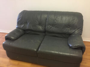 Grey Leather Love Seat for quick sale.