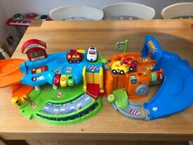 Vtech toot toot garage and race tracks (with 4 cars)
