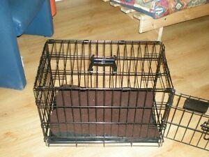 Cage pour petit chien 24'' X 14'' X 16''.