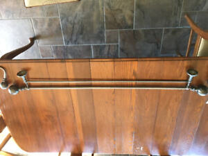 Pottery Barn set of double drapery rods with tie backs.