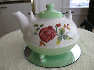A QUAINT LITTLE OLD-FASHIONED FOOTED CHINA TEA POT