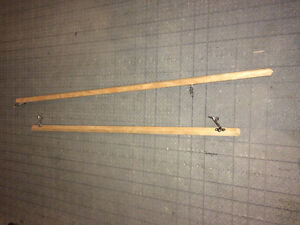 Two wood handrails with brackets