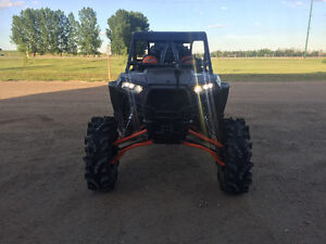 """Lifted rzr 1000 with 34"""" terminators/ custom cage"""