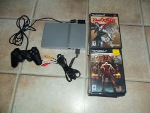 SONY PLAYSTATION 2, avec 16 jeux (PRINCE OF PERSIA, GOD OF WAR..