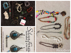 several pieces of jewellery (necklaces, earrings, bracelets)
