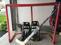 Junior goalie pads used outdoors for street,net and goalie stick