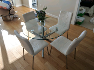 Glass table with leather chairs