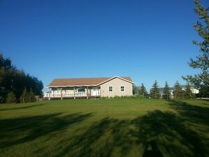 Gorgeous Acreage in Picture Butte on paved road