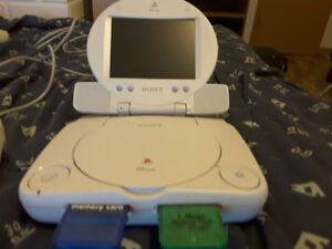 Playstation One with portable screen and nine ps one games
